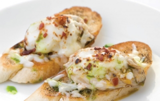 Roasted Oyster Crostini with Brûléed Parmesan and Applewood Bacon